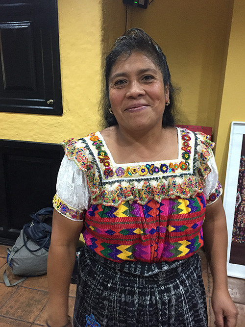 Rut Gonzalez - Santa Lucia Utatlan, Solola - Friendship Bridge client for 12 loan cycles.Ruth, along with three employees, produces our yoga mat carriers, key chains, and colourful aprons. She lives in a rural area in the department of Solola and is excited to participate in the Artisan Program.