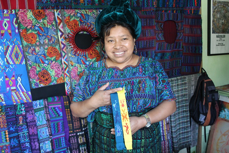 Magdalena Ajpuz - Santa Catarina Palopo - Friendship Bridge client for 19 loan cycles.Magdalena, who lives in Santa Catarina Palopo, is the matriarch of her large family. She has eight employees who help make colorful bookmarks and traditional textile greetings cards.
