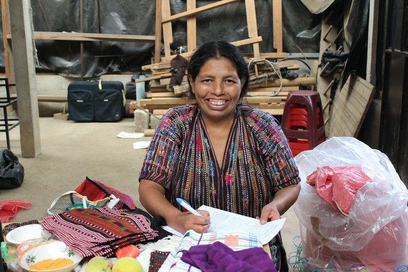 Marcela Par - El Tablon, Solola - Friendship Bridge client for 15 loan cyclesWith her big smile, tremendous joy, and motivation, Marcela weaves the fabric for dishtowels, totes, and throws on her foot looms. She has five employees able to support their own families.