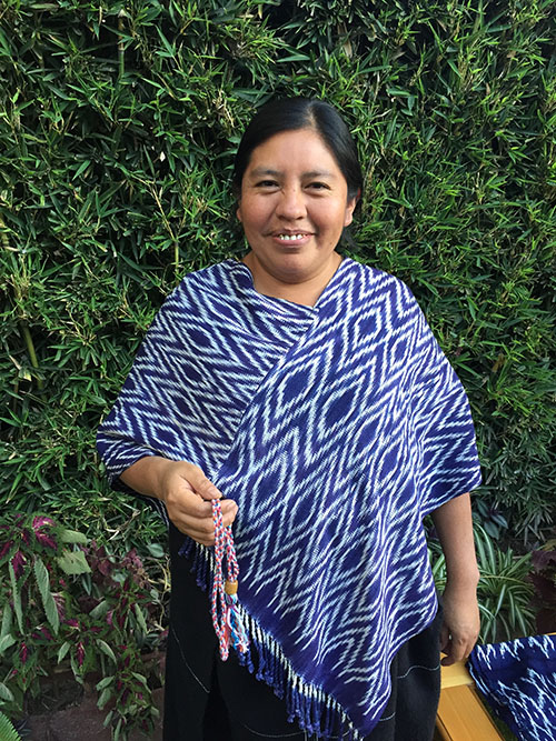Elena Ixtamer - San Juan la Laguna, Solola - Friendship Bridge client for 7 cycles.Living on the shores of the magnificent Lake Atitlan, Elena draws inspiration from her surrounding to weave elegant ponchos and pillows. She has four employees.