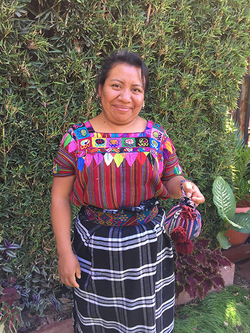 Milvia Xicay - Patzun - Friendship Bridge client for 3 loan cycles.Milvia enjoys re-purposing beautiful fabrics for our popular jewellery bags. She feels lucky to participate in the Microcredit Plus program of Friendship Bridge.