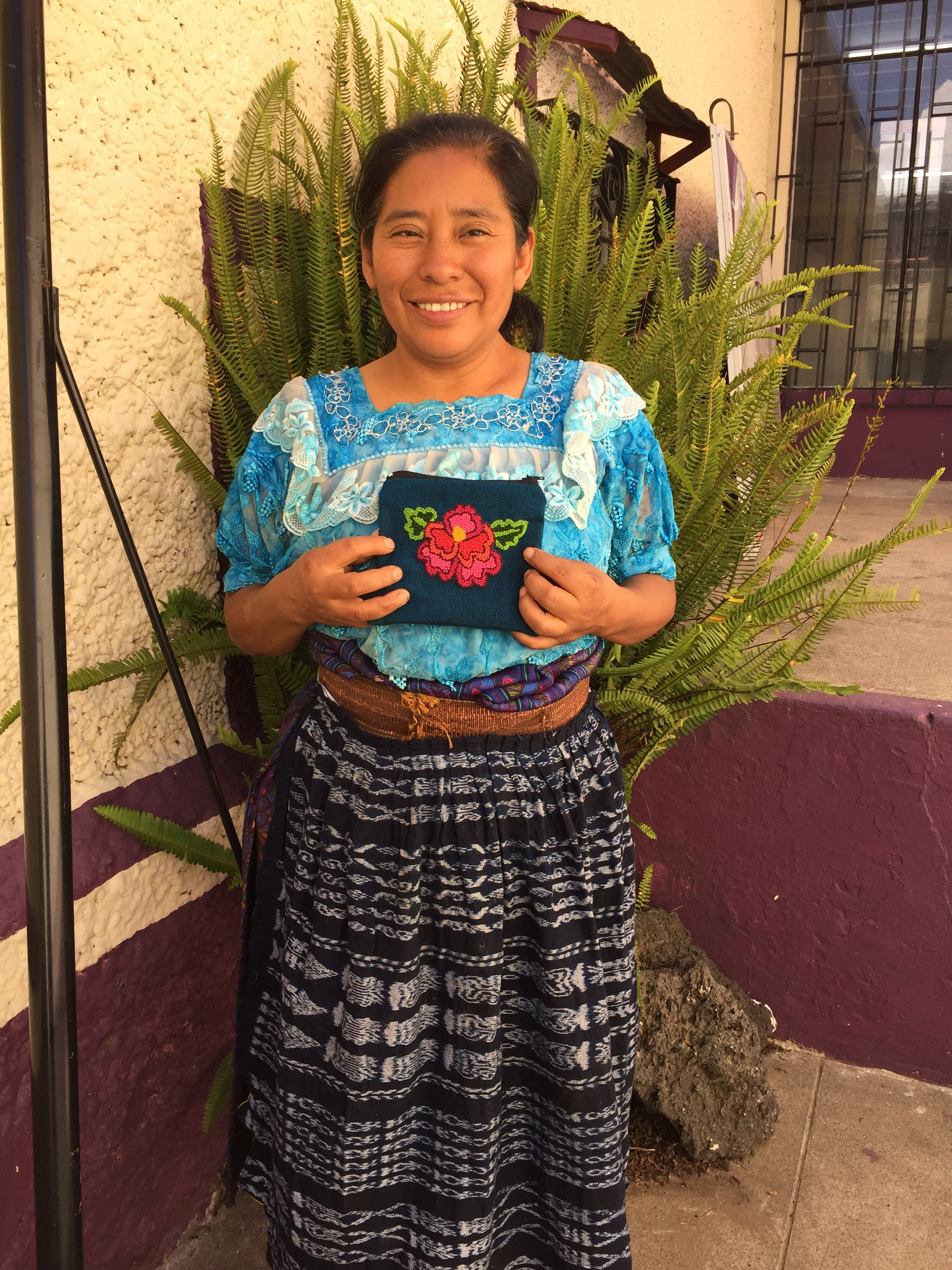 Rosario Yac - Cantel, Quetzaltenango - Friendship Bridge's client for 12 loan cycles.Living in the large department of Quetzaltenango, Rosario embroiders our small zippered pouches. She has one employee.
