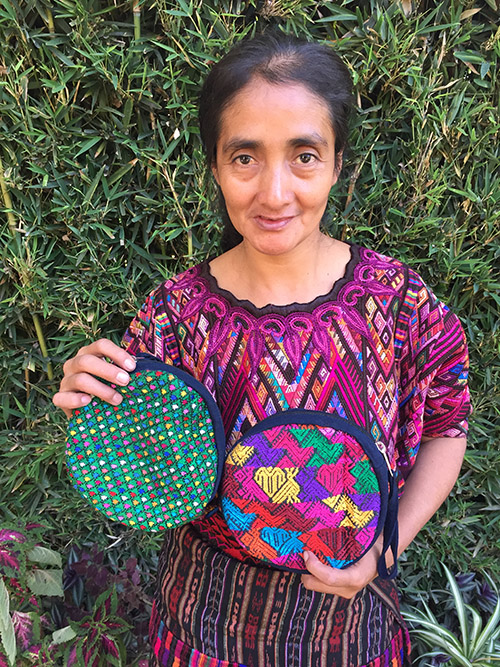 Martina Suy - Chichicastenango - Friendship Bridge's client for 6 loan cycles.Martina, whose passion for her work is unmistakable, contributes not only this wonderful huipil tote to our collection, but also our colorful zippered bags and tassel keychains. Customers report that her products have a variety of uses, and they are in high demand.