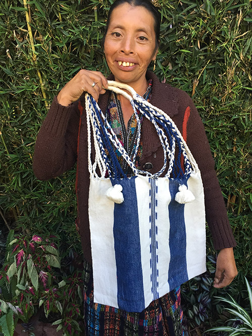 Santos Quisquina - Solola - Friendship Bridge's client for 9 loan cycles.Santos is an award-winning textile artisan who is thrilled to participate in the Microcredit Plus program. She skillfully weaves elegant purses, table runners and scarves along with six employees.
