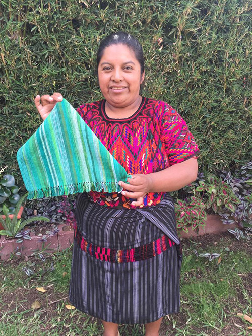 Yolanda Calgua - Chichicastenango - Friendship Bridge's client for 11 loan cycles.Working on a traditional backstrap loom, Yolanda and her ten employees weave beautiful placemats that enjoy high demand.