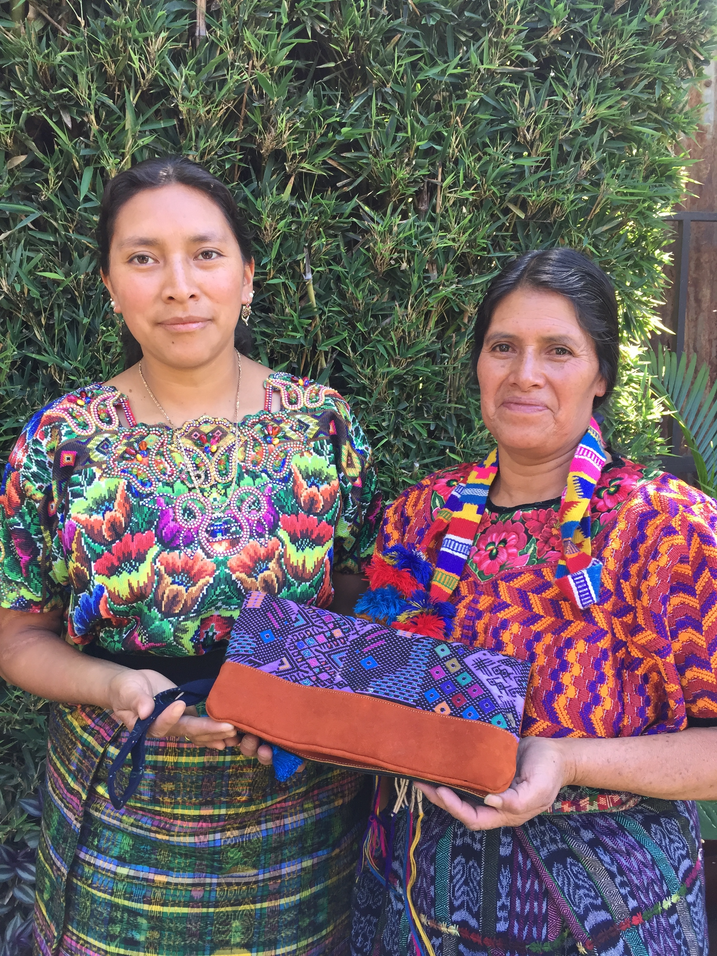 Micaela Garcia & Erika Sam - Cantel, Quetzaltenango - Friendship Bridge's clients for 4 cycles.This mother and daughter-in-law team is talented and unique. They produce our colorful soft fabric trays, as well as our clutches and bags, combining re-purposed huipils and leather.