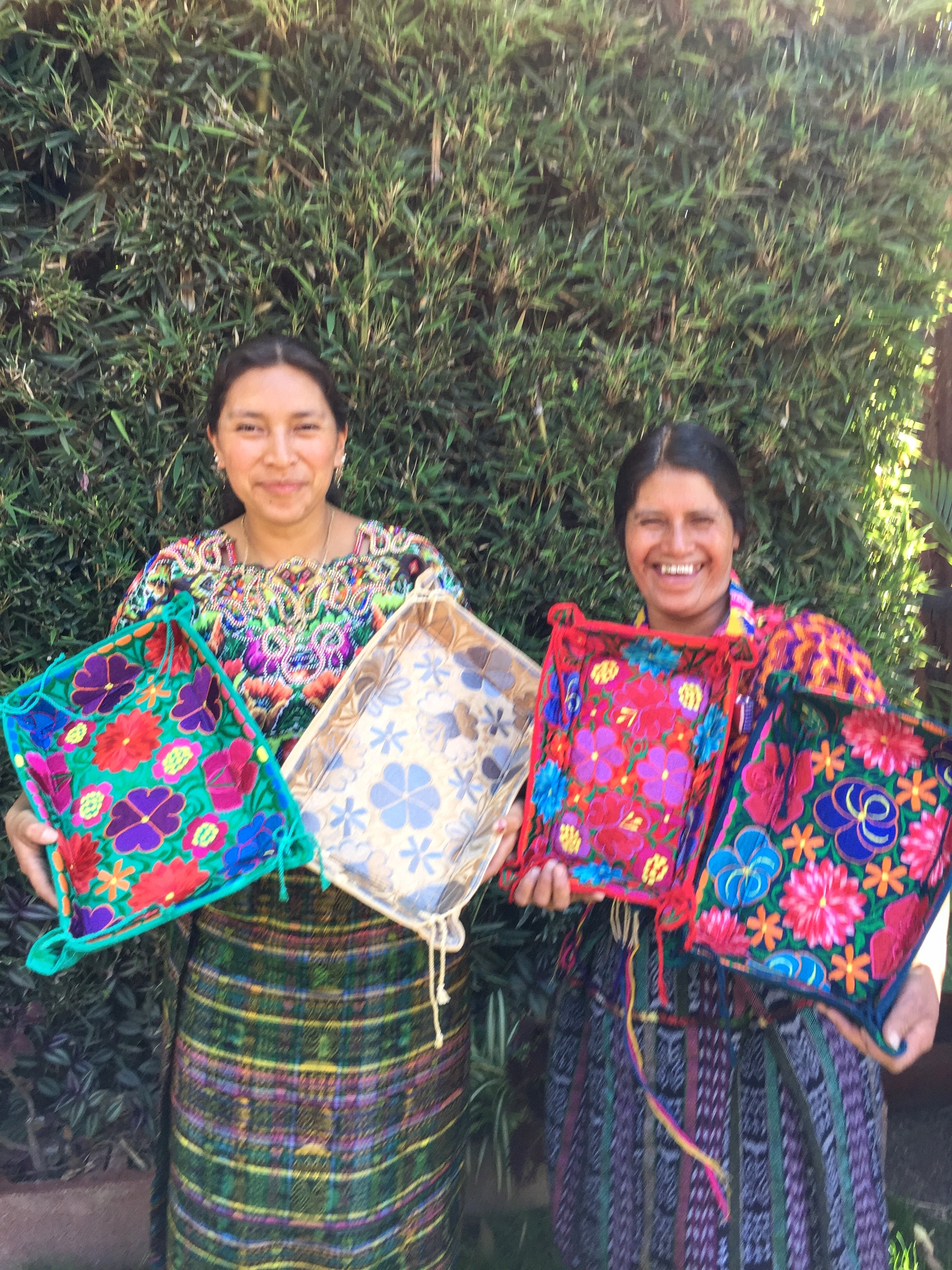 Erika Sop & Micaela Garcia - Cantel, Quetzaltenango - Friendship Bridge's clients for 4 cycles.This mother and daughter-in-law team is talented and unique. They produce our colorful soft fabric trays, as well as our clutches and bags, combining re-purposed huipils and leather.