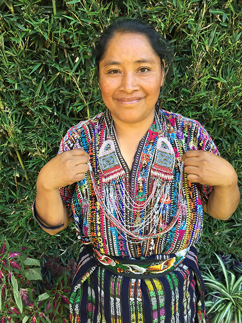 María Ajiquichi - El Tablón, Sololá - Friendship Bridge's client for 5 loan cycles.Exploding with creativity and talent, María has created this splendid Tapestry Huipil Cuff as well as our lovely beaded coin purses. She has 25 employees.