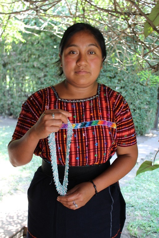 Lidia Par - El Tablon, Solola - Friendship Bridge's client for 12 loan cycles.Lidia, a skilled artisan, has overcome health challenges to produce beaded jewelry and attractive leather cuffs for our collection. She has five employees.