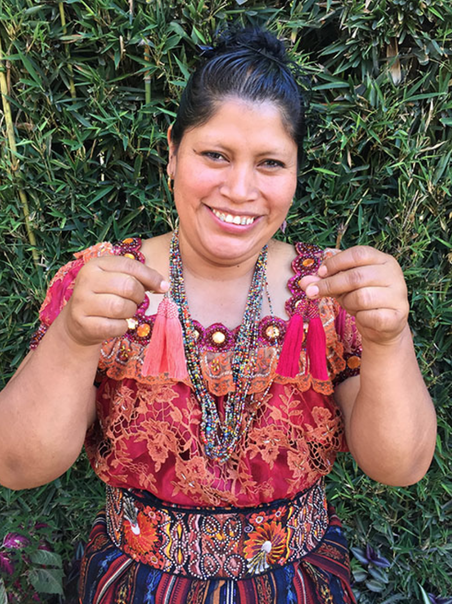 Olga Tunay - Chiaquijya, Sololá - Friendship Bridge's client for 15 loan cycles.Olga, along with 26 employees, creates unique and striking jewelry and handcrafts. Her tremendous talent, energy, and enthusiasm for what she does are undeniable and evident in her work.