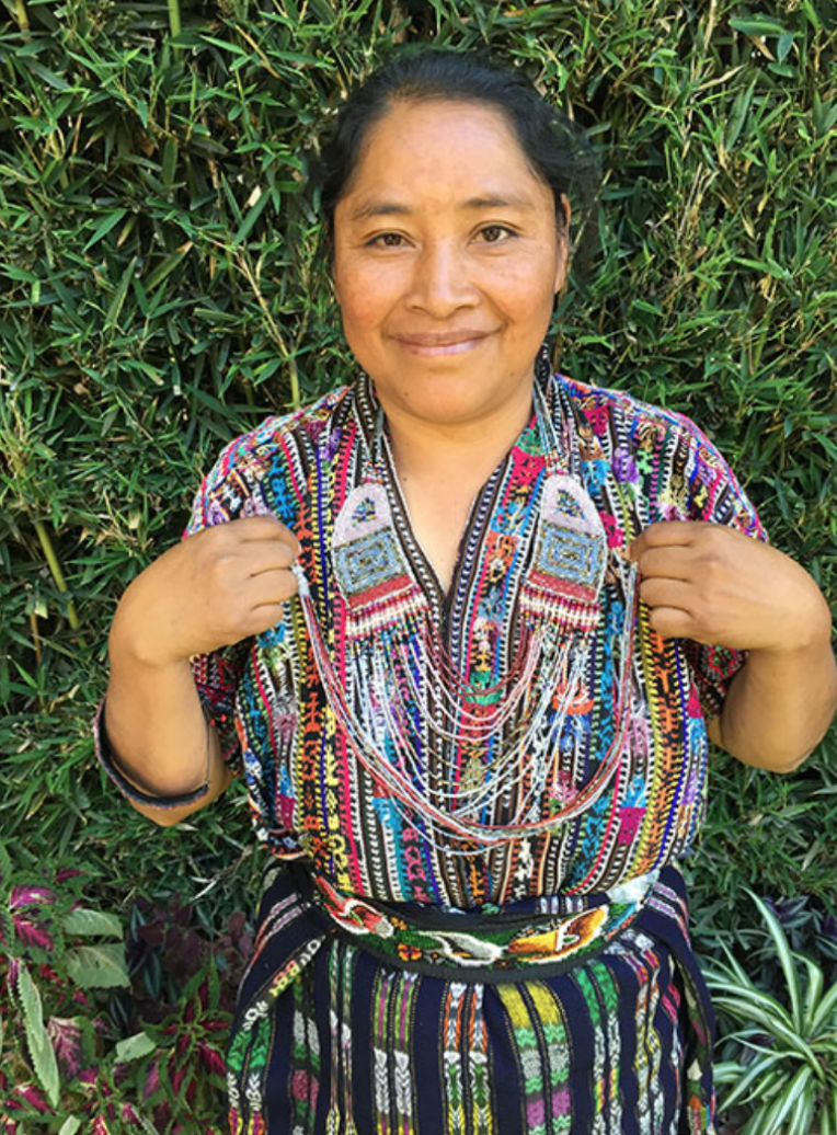 María Ajiquichi - El Tablón, Sololá - Friendship Bridge's client for 5 loan cycles.Exploding with creativity and talent, María has created variations of these exquisite and handy beaded coin purses. She has 25 employees.