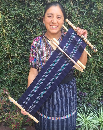 Candelaria Julajuj - Peña Blanca, Sololá - Friendship Bridge's client for 8 loan cycles.Candelaria is one of the youngest artisans in our Program. A very gifted backstrap weaver with an undeniable enthusiasm for what she does, Candelaria creates scarves for both men and women. She has two employees who help her develop orders.