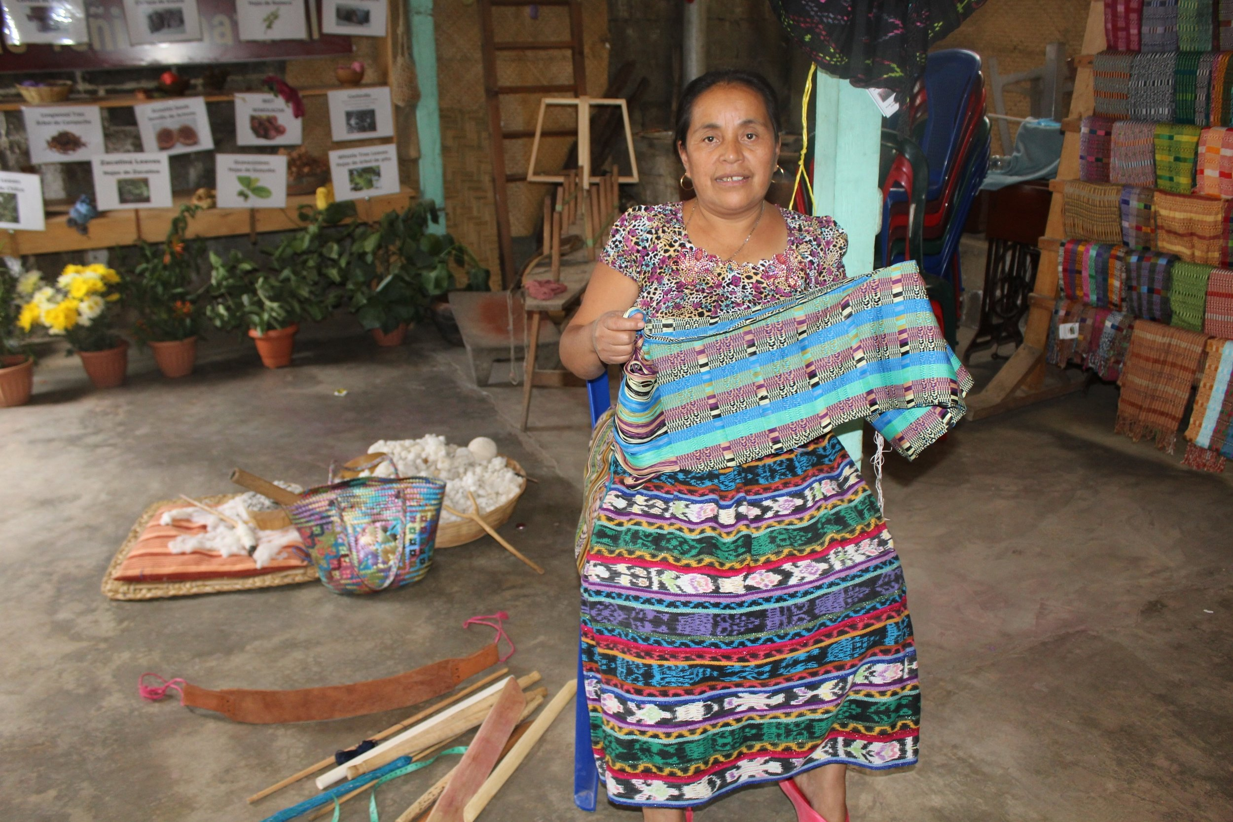 Dominga Perez - San Juan La Laguna - Friendship Bridge's client for 5 loan cycles.Dominga eagerly attends her Monthly Trust Bank meetings and has learned a great deal about business practices, health, family issues, and women's empowerment. Her dedication to develop beautiful products is evident through such creations as these Jaspe Shawls.
