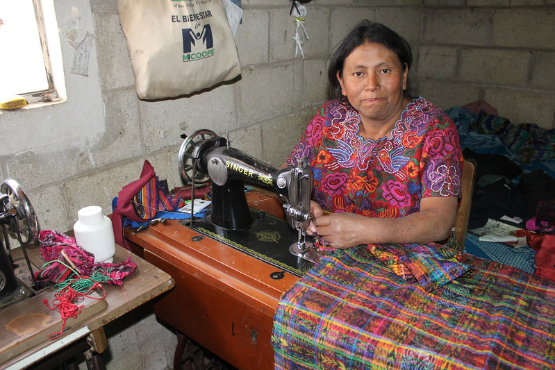 Rosario Yac - Cantel, Quetzaltenango - Friendship Bridge's client for 12 loan cycles.Rosario's passion for her work and her motivation to produce beautitful creations are evident. She embroiders these delightful pillow covers as well as our small zippered pouches. Rosario has five employees.