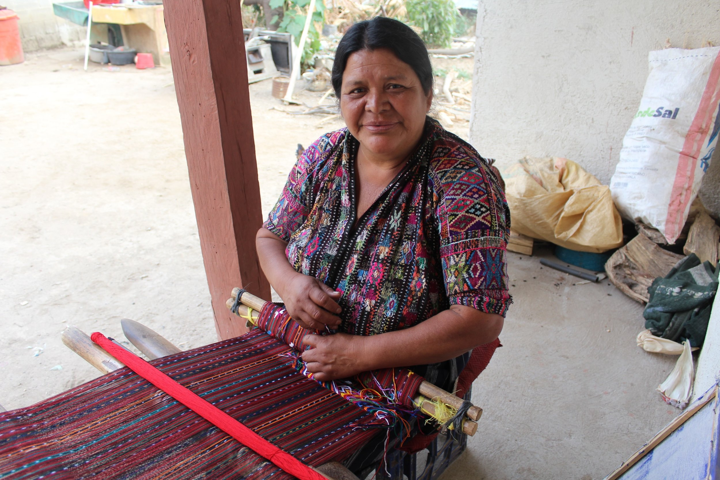 Francisca Tun - Monte Mercedes, Sololá - Friendship Bridge's client for 14 loan cycles.With her strong presence and motivation, Francisca is pleased to be one of our featured artisans. Along with two employees, she weaves both table runners and bookmarks on her backstrap loom.