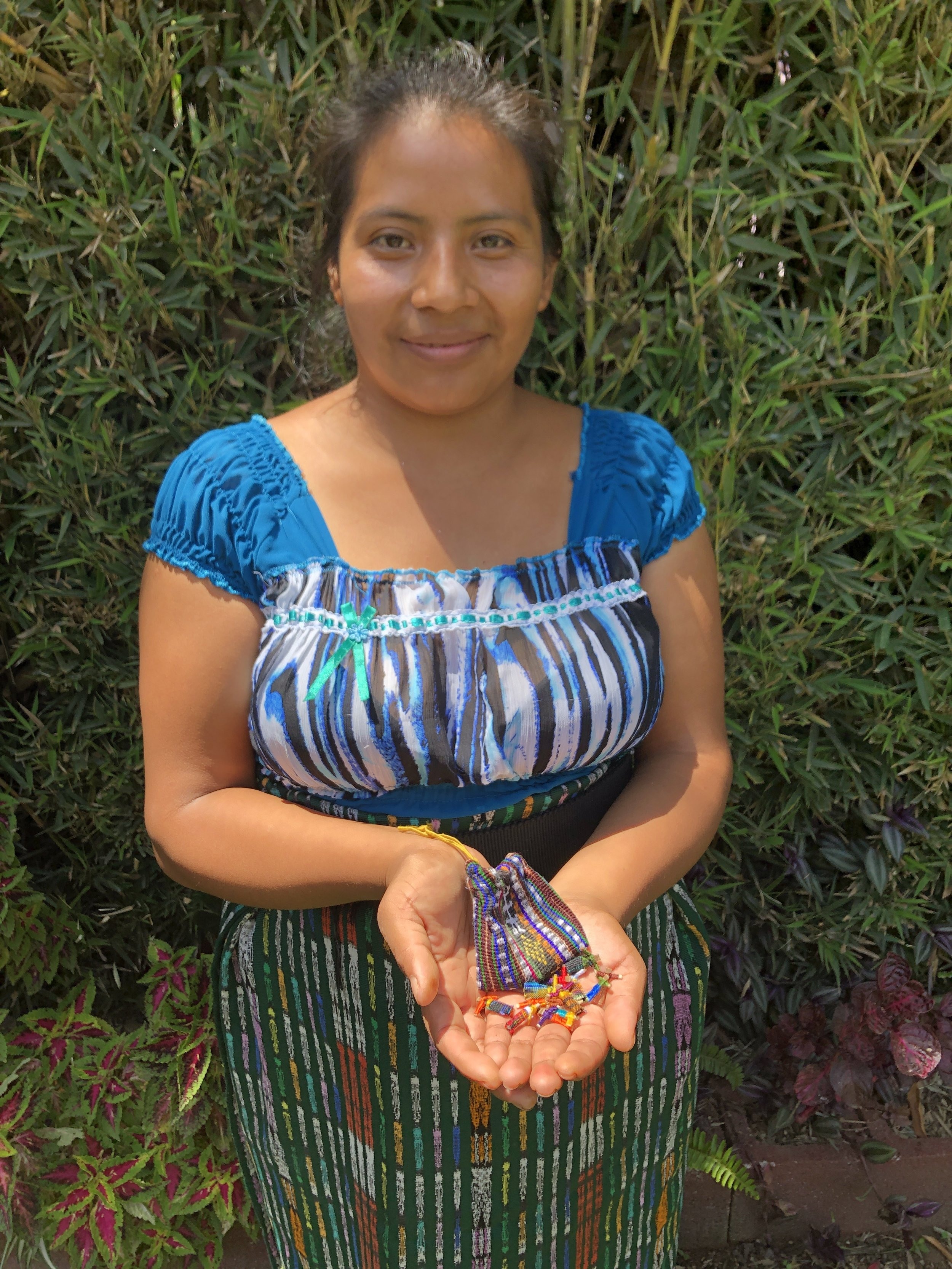 Mirian Zet - San Jorge La Laguna, Sololá - Friendship Bridge's client for 9 loan cycles.Mirian has contributed not only these authentic worry dolls to our collection, but also wonderful boho earrings, pompom necklaces, wire bracelets and an eyeglasses chain. Many ladies in Mirian's town are skilled bead artisans, and Mirian is no exception. Her persistence to create unique new products makes her a key participant of our Artisan Program.
