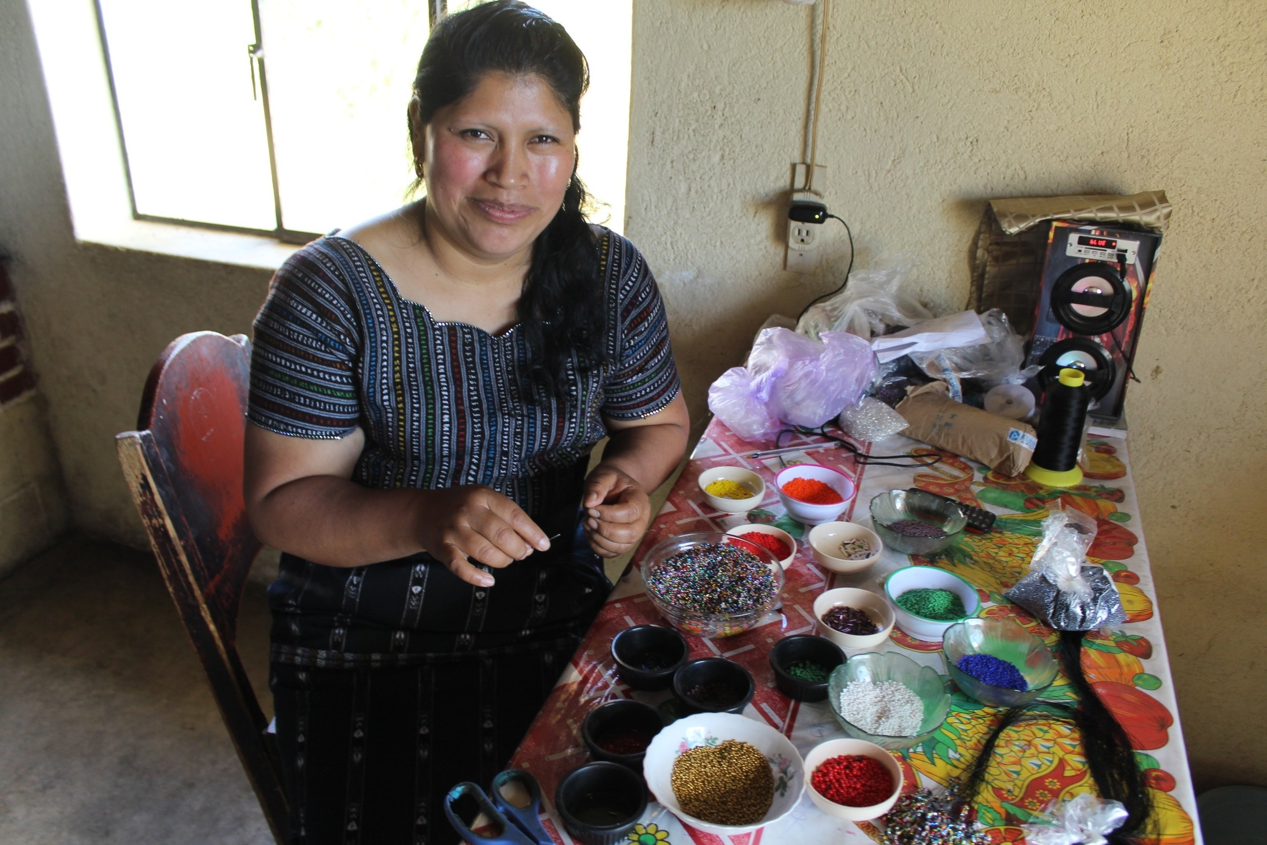 Olga Tunay - Chiaquijya, Sololá - Friendship Bridge's client for 15 loan cycles.Olga, along with 28 employees, creates unique and striking jewelry and handcrafts. Her tremendous talent, energy, and enthusiasm for what she does are undeniable and evident in her work.