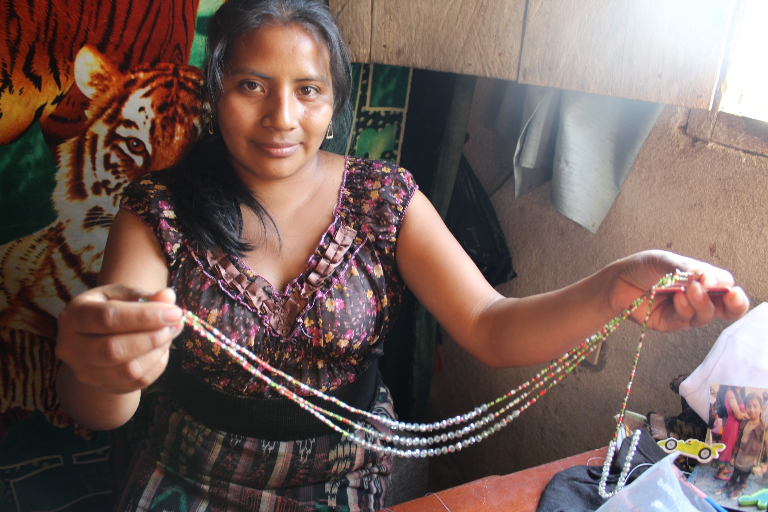 Mirian Zet - San Jorge La Laguna - Friendship Bridge's client for 9 loan cycles.Mirian has contributed not only this festive ball ornament cover, but also our corte christmas tree ornament, stunning earrings, necklaces, and a bookmark to our collection. Many ladies in Mirian's town are skilled bead artisans, and Mirian is no exception. Her persistence to create unique new products makes her a key participant of our Artisan Program. She has nine employees.