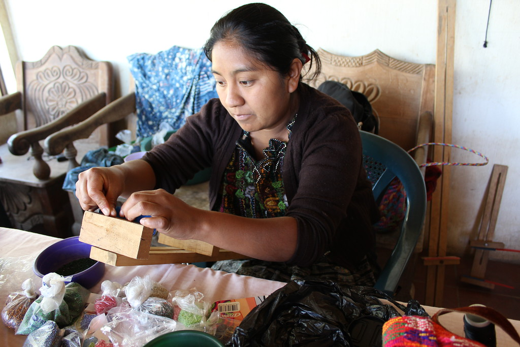 Lidia Par - El Tablón, Sololá - Friendship Bridge's client for 13 loan cycles.Lidia, a skilled artisan, has overcome health challenges, and her tenacity and desire to continue creating such elaborate products as these beaded ornaments as well as the Christmas Daisy necklace and bracelet for our collection are exemplary. She has seven employees.