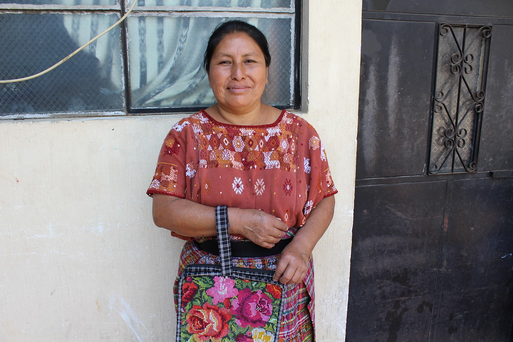 Jacinta Xon - Chimaltenango - Friendship Bridge's client for 13 loan cycles.Jacinta is a prolific seamstress who has tremendous talent and energy to – with the help of her three employees – sew such wonderful products as this tablet pouch as well as the huipil tennis backpack in our collection. She has three employees.