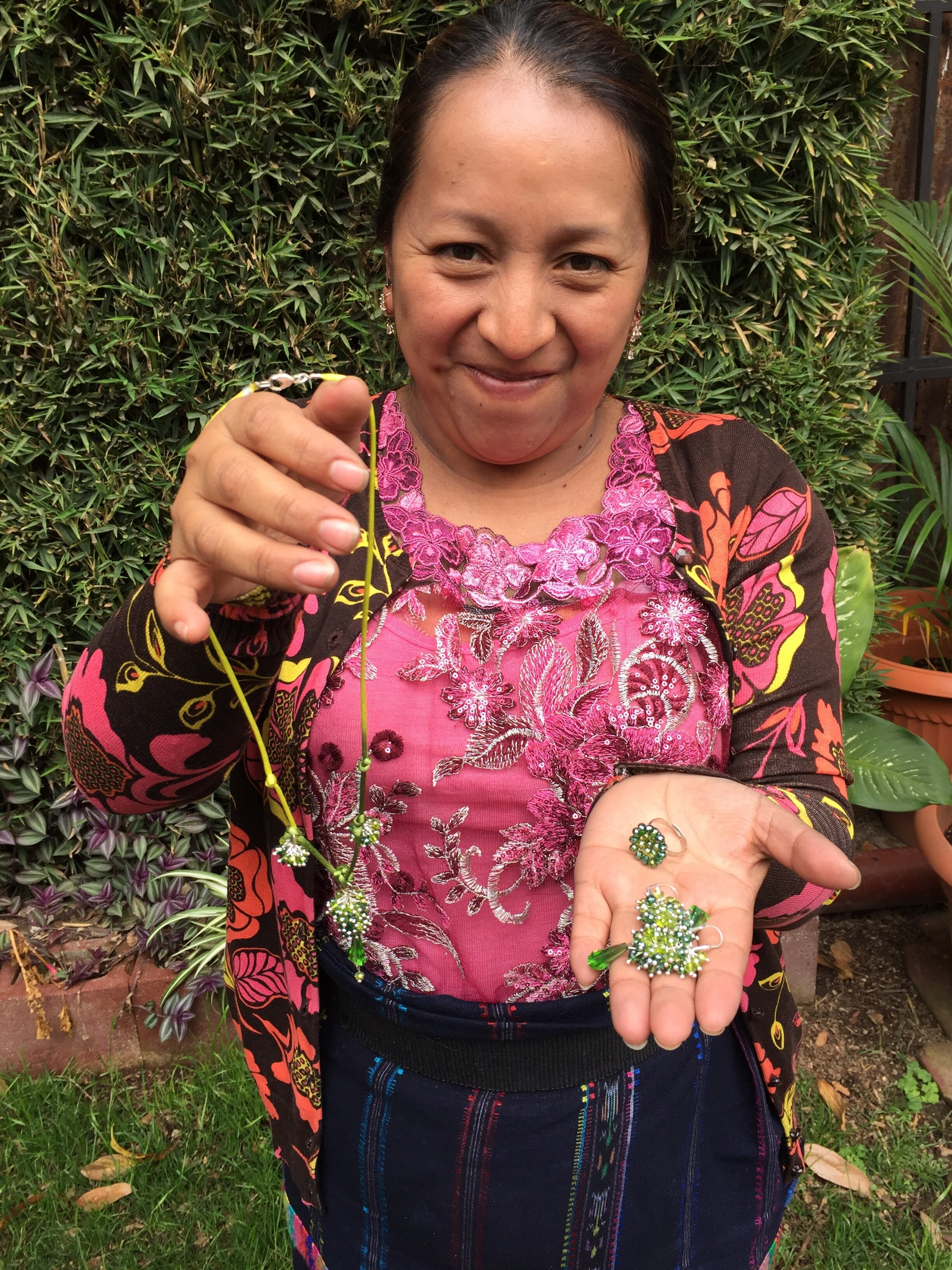 María Magda Tembriz - Nahuala, Sololá - Friendship Bridge's client for 11 loan cycles.María elaborates her products with beading. She contributes this handy huipil keychain as well as the extraordinary ornament earrings and sweet angel earrings to our collection. She is thankful for this great opportunity to generate income for her family.