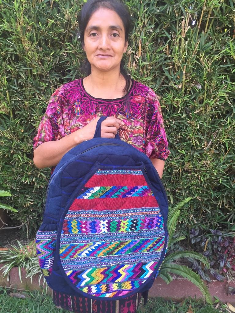 Martina Suy - Sepelá, Chichicastenango - Friendship Bridge's client for 6 loan cycles.Martina, whose passion for her work is unmistakable, creates these coveted tennis backpacks, as well as such products as the Christmas stockings, advent calendars, eyeglasses case, and pencil case bag in this holiday collection! Customers report that her products are of admirable quality, and they are in high demand.