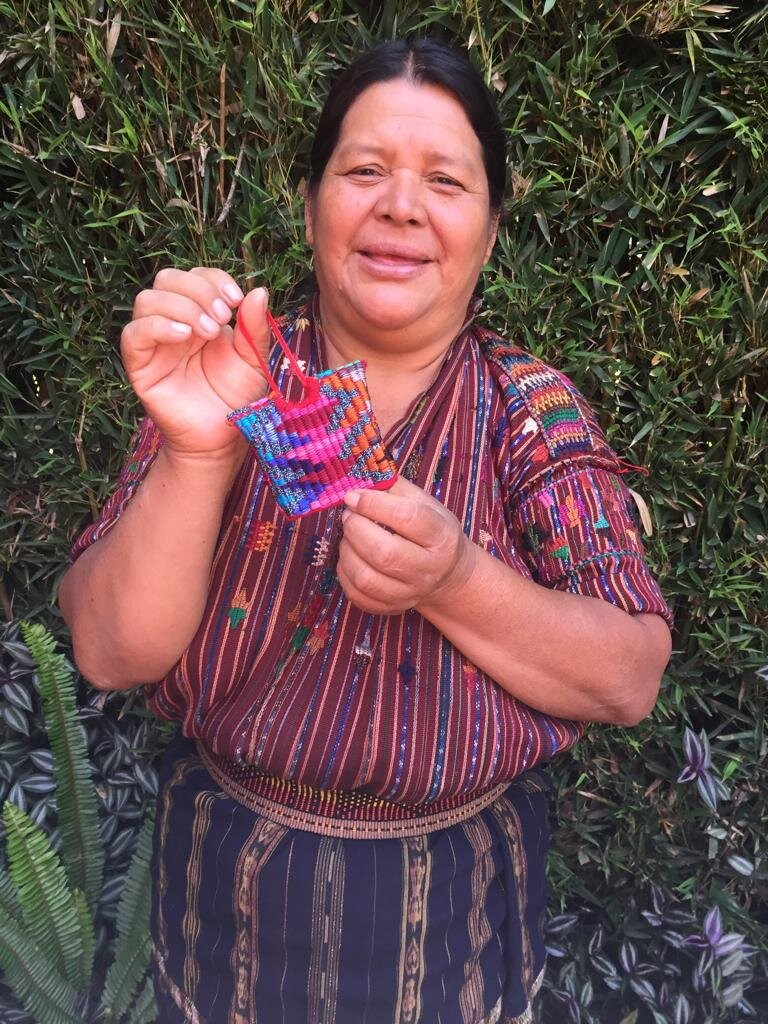 Francisca Tun - Monte Mercedes, Sololá - Friendship Bridge's client for 14 cycles.With her strong presence and motivation, Francisca is pleased to be one of our featured artisans. Along with two employees, she not only creates these exquisite mayan huipilito ornaments, but also weaves bookmarks and table runners on her backstrap loom.