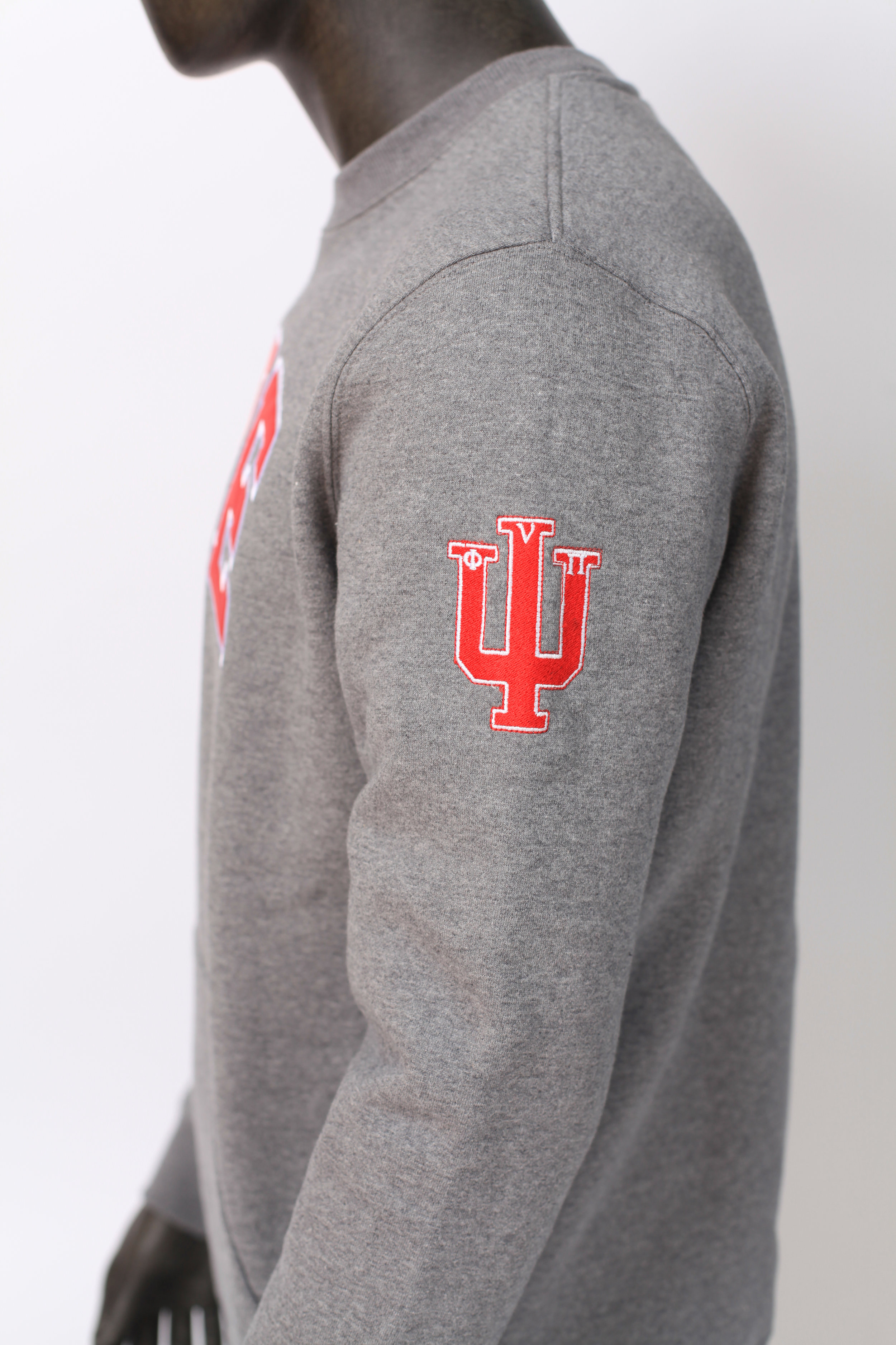 Sleeve of gray sweatshirt