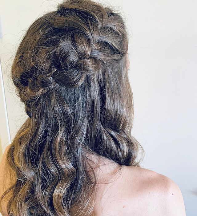 Simple braids for a half up look.  What looks do you want to see more of?! What's your go to look for wedding season?  #bridesmaidhair #braids #simplebraids #updo #styles #hairstyling #hottoolscurlbar #oribe #waves #emilywoodstromhair
