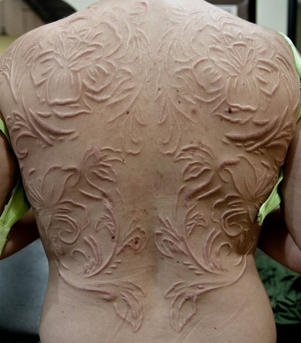 Beautifully healed scarification. A white tattoo looks nothing like this, nor as gorgeous.