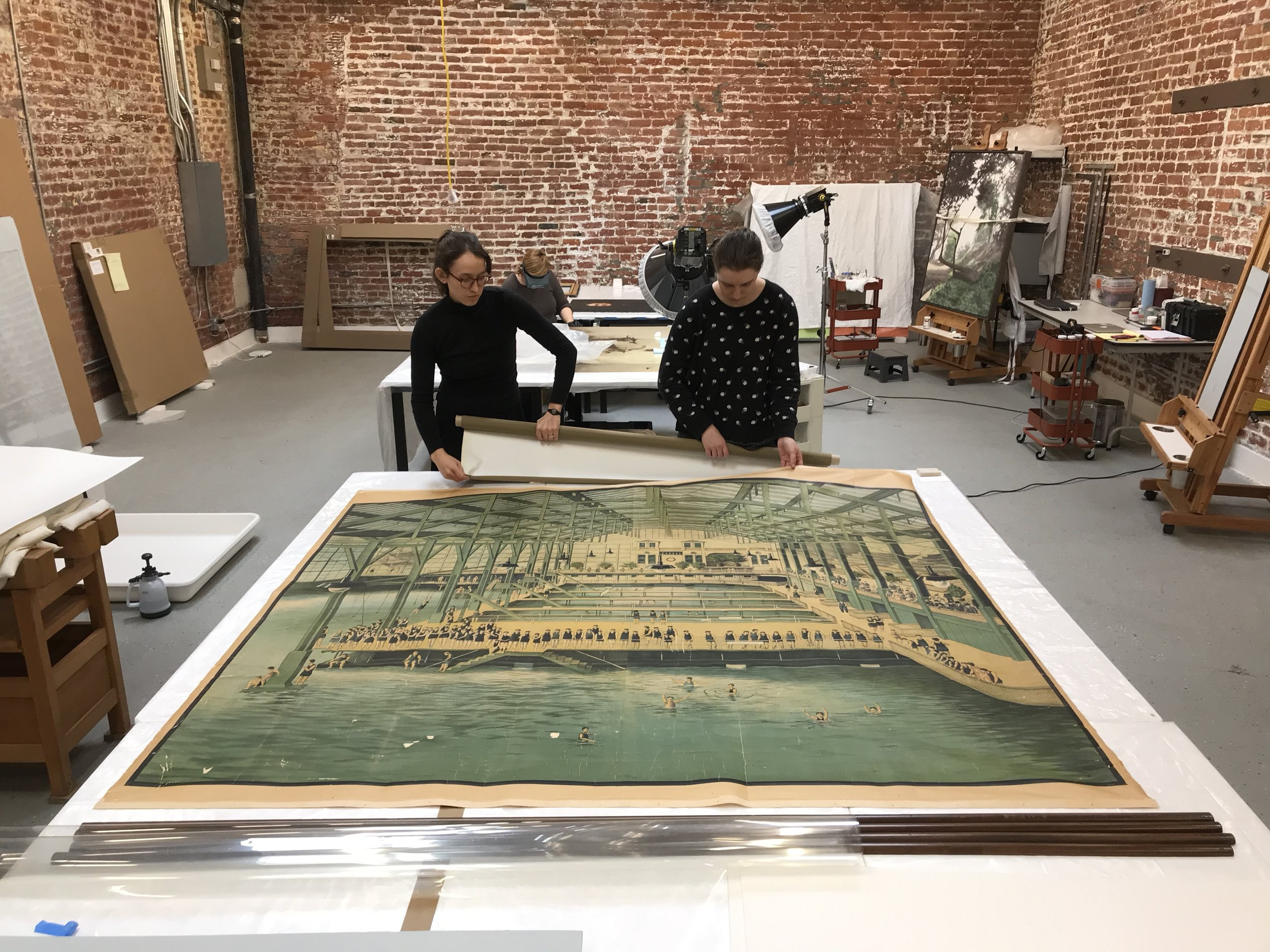 Treatment of an oversized work on paper, an early advertising poster for Sutro Baths from the collection of a private client.