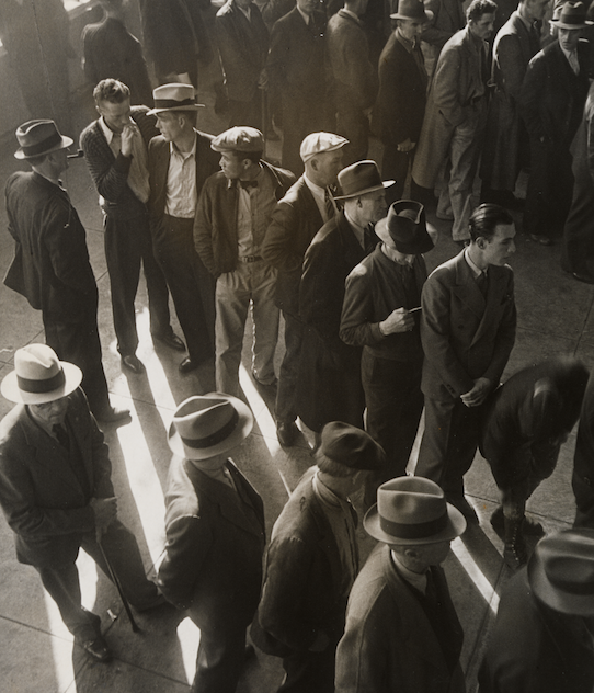 """Jobless men line up for first-time compensation.""—Records of the Social Security Administration (RG47)."