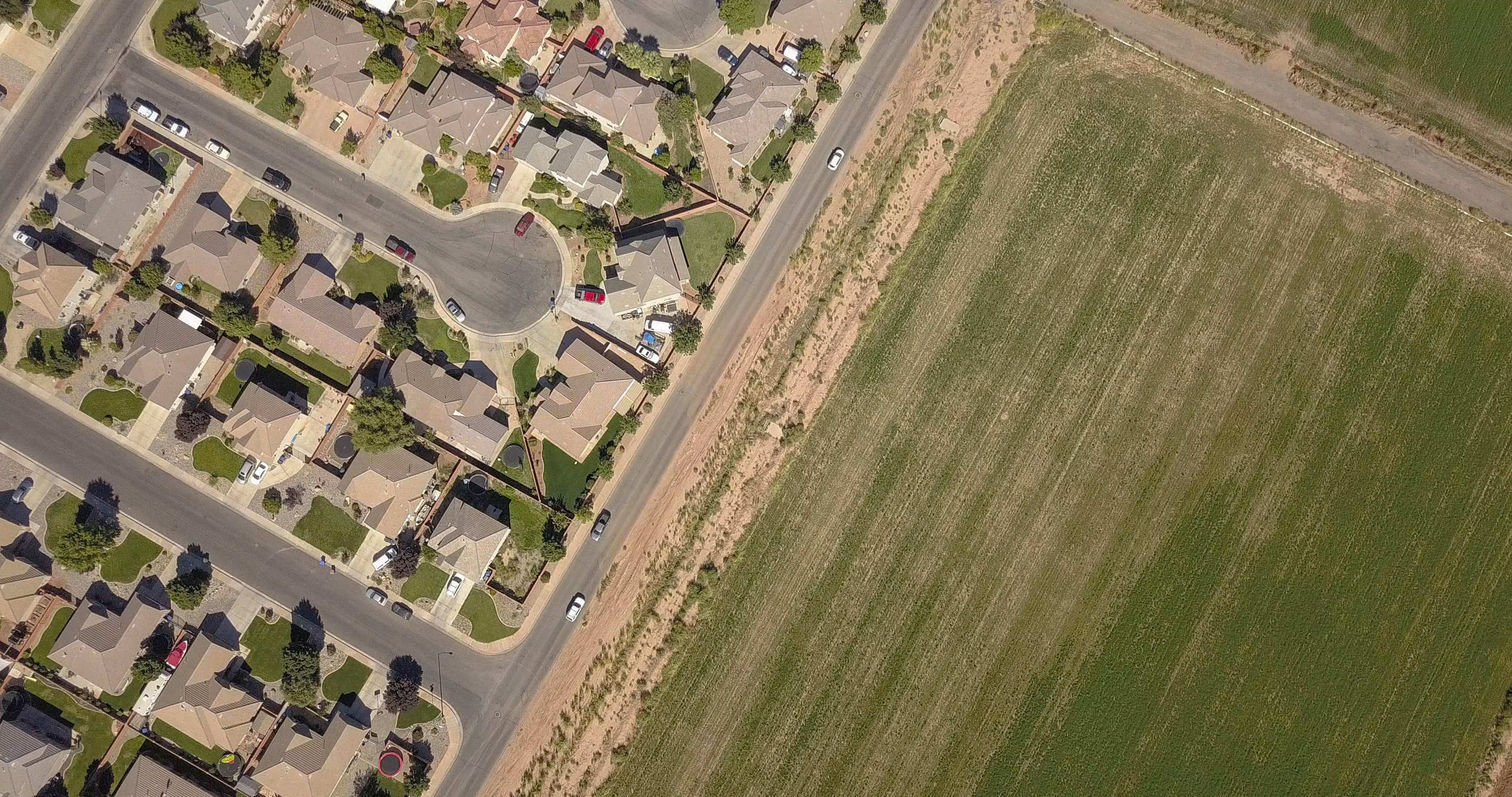 Irrigated farmland is being replaced by homes, strip malls, streets and parking lots which use much less water or no water whatsoever.