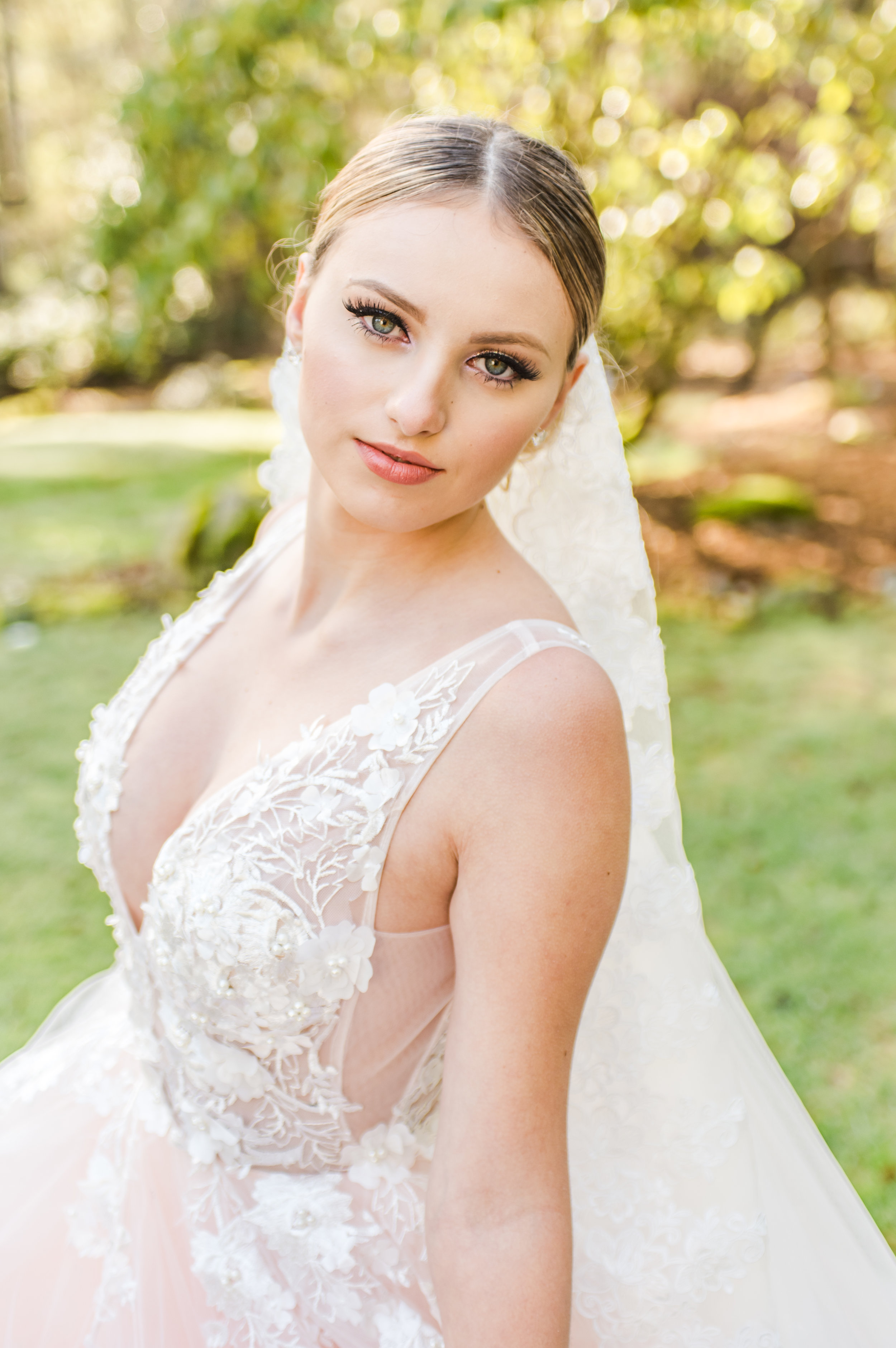 Bride smirks at camera in green yard