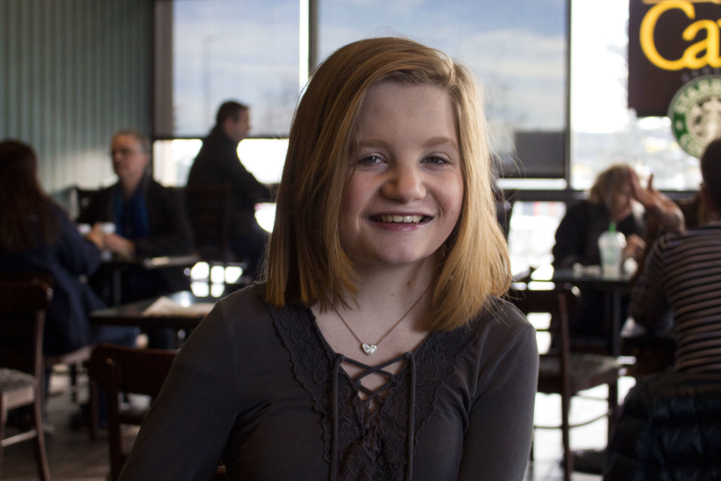 """Despite having health issues, 14-year-old Ashley Perry takes action in the Anchorage community through the creation of the """"Shelter Animals Program."""" Photo credit: Mizelle Mayo"""