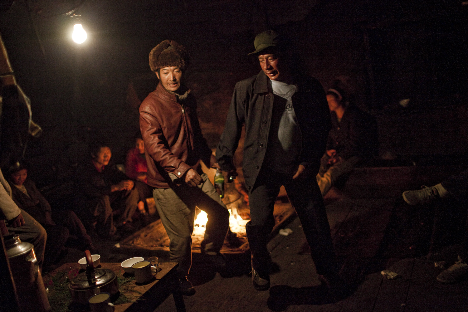 Qiunatong Village, Yunnan. Nu villagers gather at a home to drink and dance. At midnight on New Years Eve everyone was supposed to drink spring water but most never made it out of these house parties.
