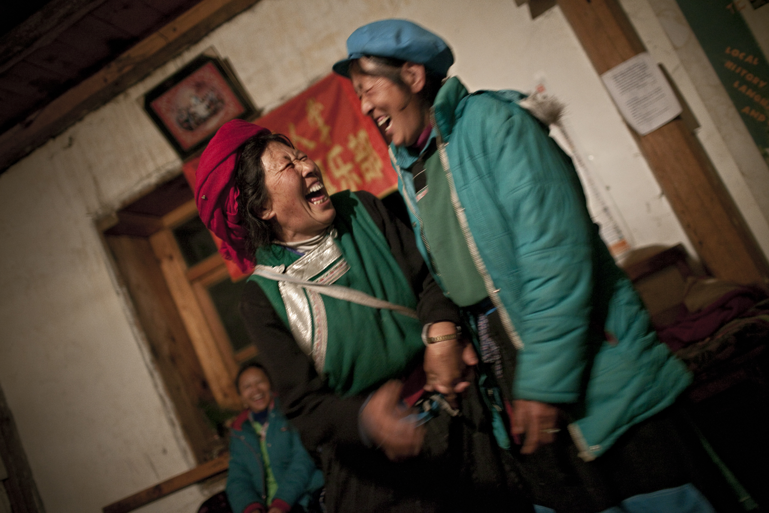 Dimaluo, Yunnan. Dimaluo is a Tibetan Catholic village on a tributary to the Nujiang called the same name. The villagers celebrate New Years by drinking corn based alchohol, singing Tibetan songs and dancing. For Tibetans in this area its a challenge to maintain their cultural practices and language. Since the area is only partially Tibetan the schools don't teach Tibetan language or culture.