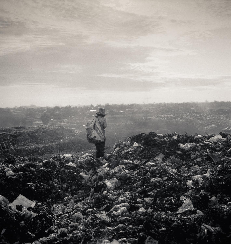 landfill woman with bag.jpg