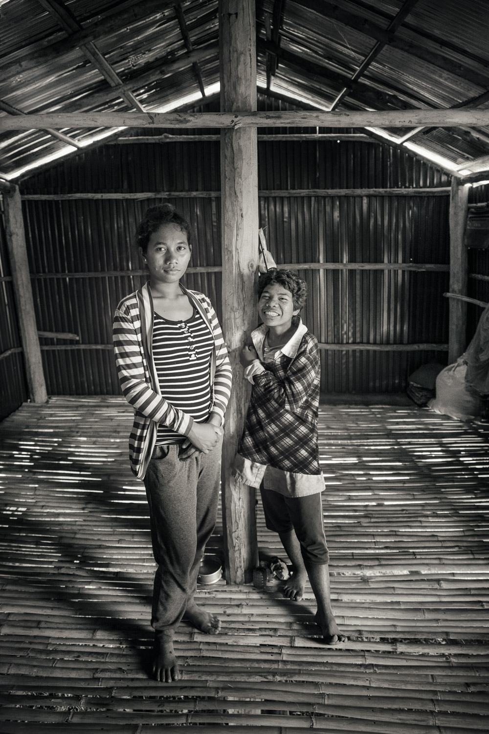 Orng Chea and her sister in the house that DDP helped to construct.  Orng Chea is hard of hearing.  These sisters lost their parents to illness.  When our outreach team met them, while seeking out future participants for the basic education project, they were living in a ramshackle, dilapidated shack.  Sopheak, the sign language interpreter in Kampot, sought out assistance for the sisters through another non-profit organization that helps to providing housing to those most in need.