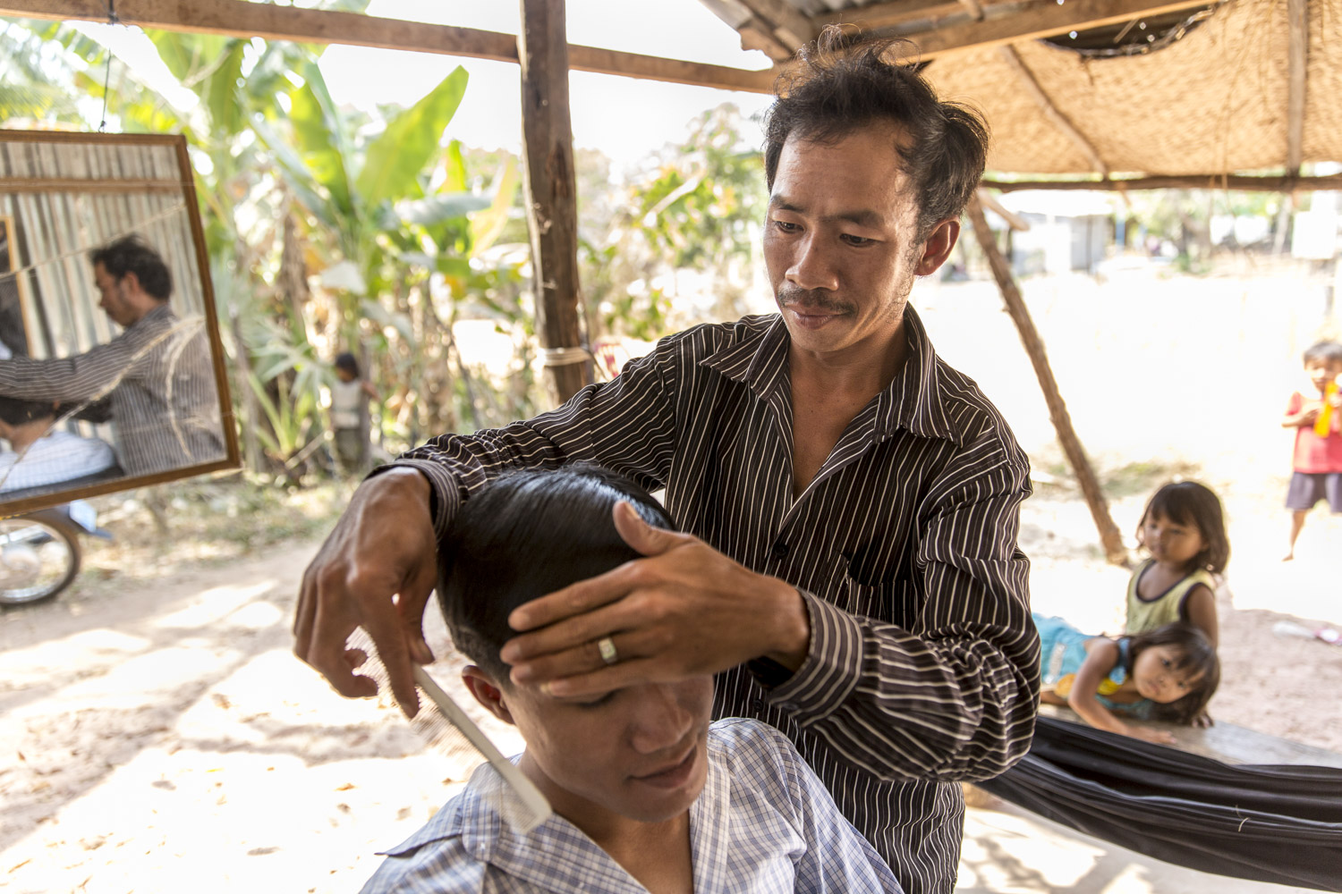 Kop is a barber training graduate from DDP, he has been operating his own barber shop since 2014. 37 yrs old.  Before opening his shop, Kop attended the DDP education program in Kampot and vocational training in Phnom Penh.  He lives with his mother and siblings, as well as a number of nieces and nephews.