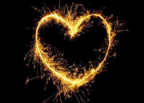 Sparkling golden heart on black background