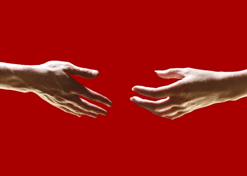 Hands Reaching Toward One Another