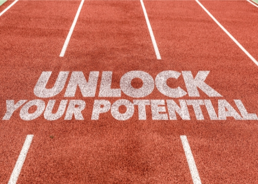 """Words """"Unlock Your Potential"""" on running track"""