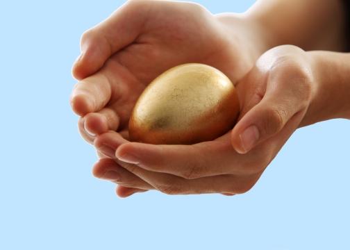 Gold egg in hands