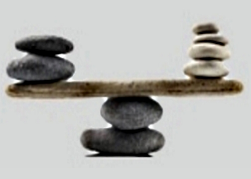 Balanced rocks on piece of wood