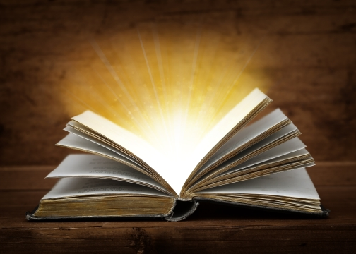Open book with glow coming from pages