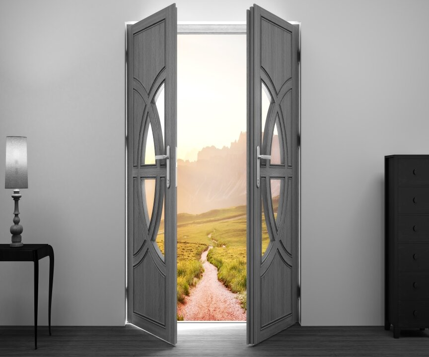 Grey doors opening to path outside