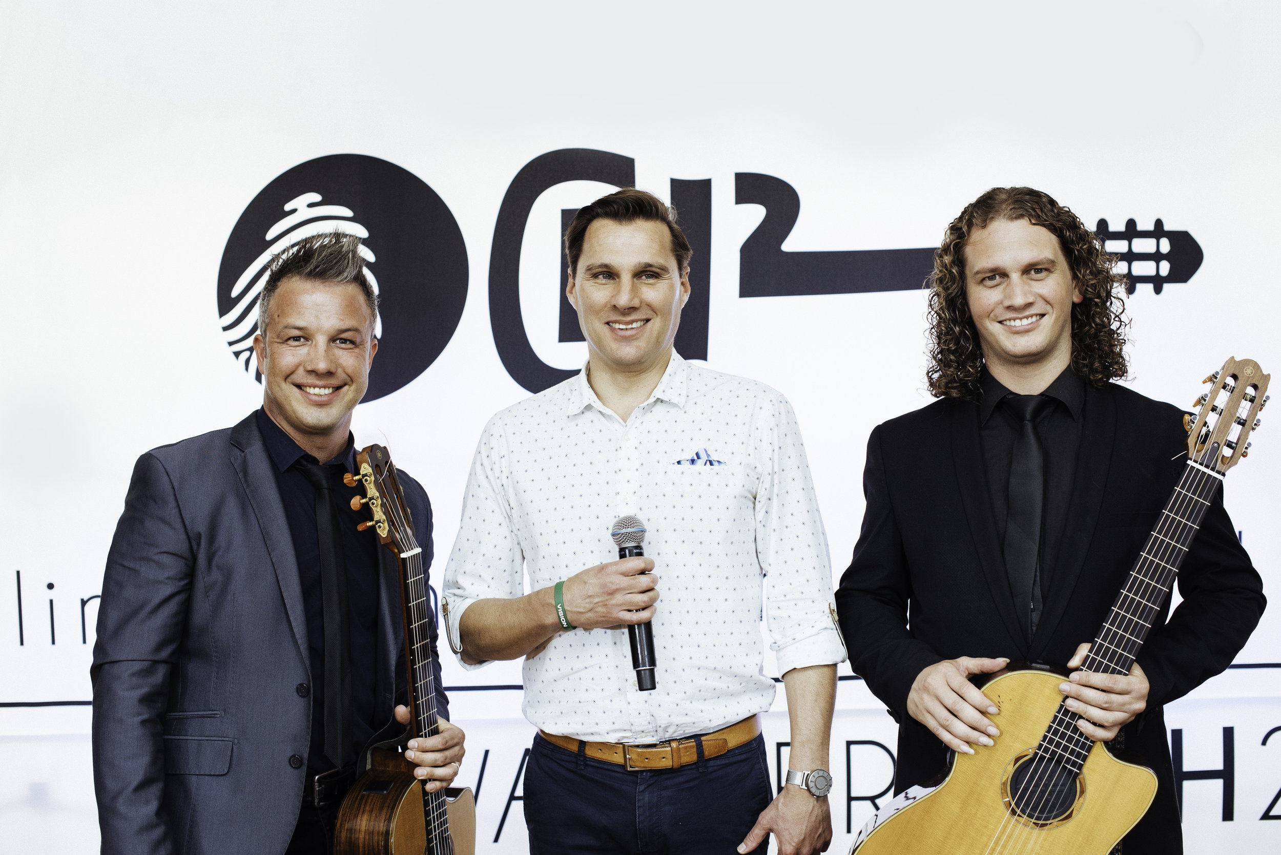 Image of Hein standing in the middle of the band CH2. On the left is Corneille and on the right is Dirkie.