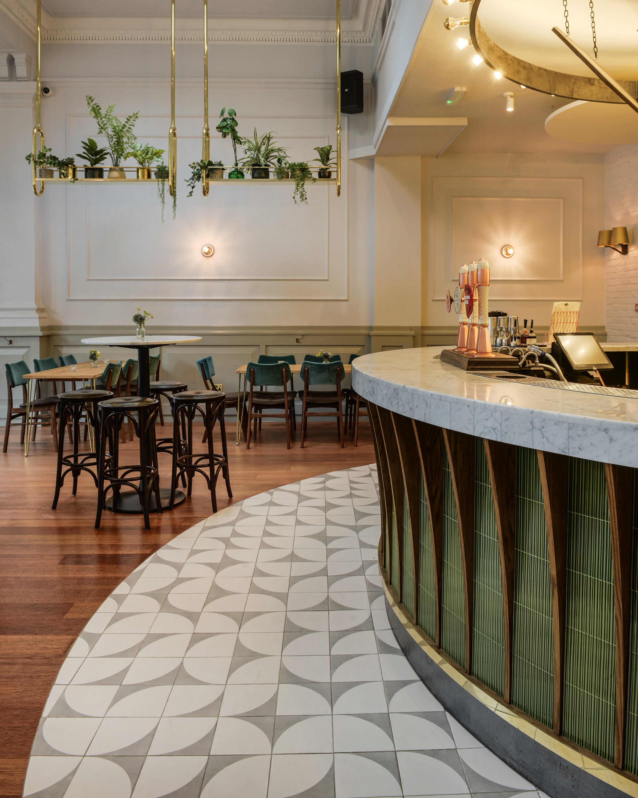 The Bank, Clapham - Our 'Dots' range of tiles, in grey, used as bar surround in this stunning pub.