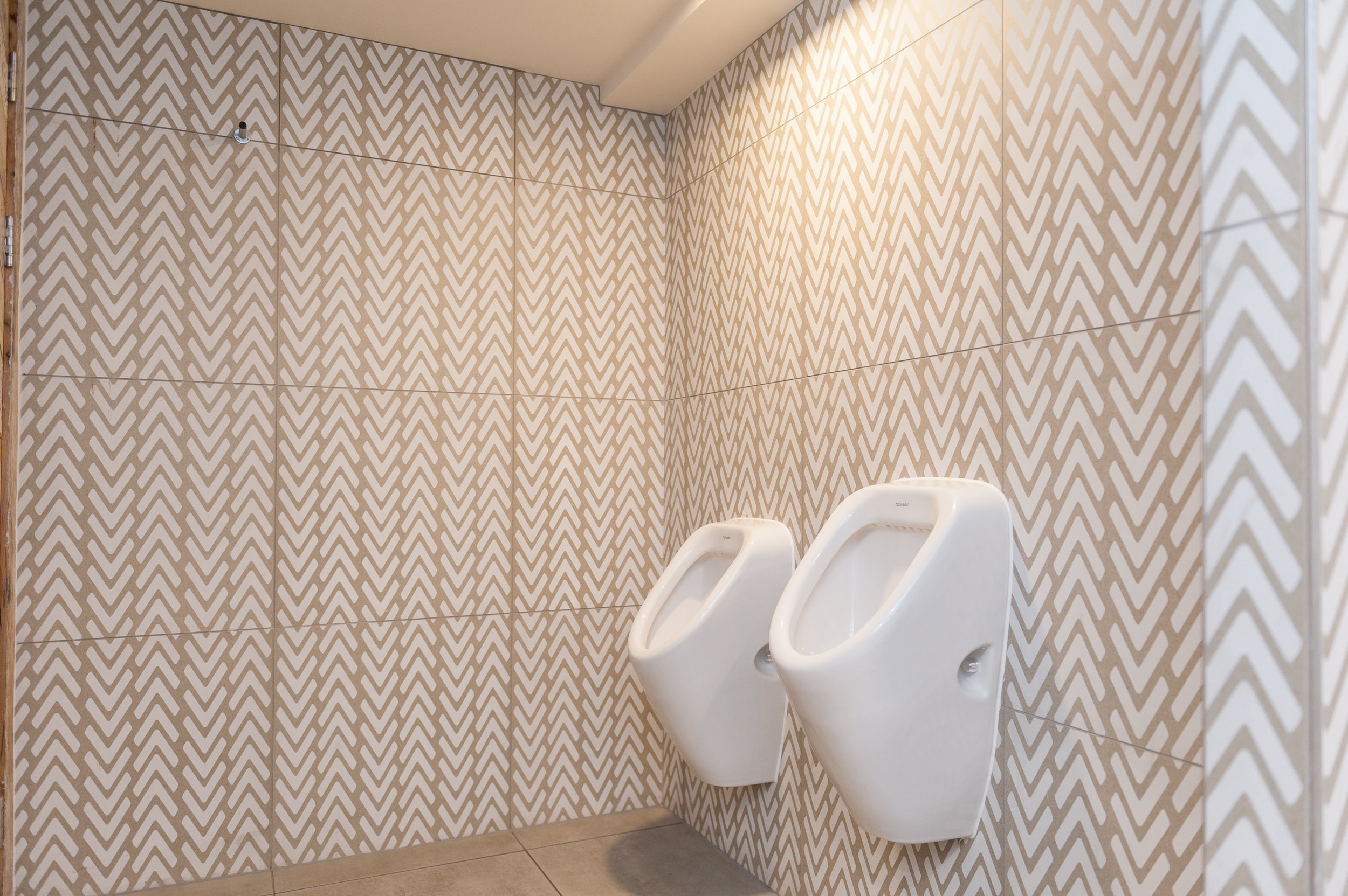 Nando's, Nottingham… - Our Felice range of 60x60cm porcelain tiles used in this Nando's WC.